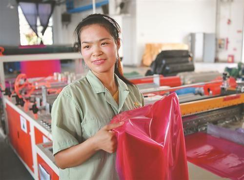 中扬镇陈秋芳返乡就业已两年了。