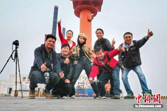 全球旅拍大赛部分摄影师合影。 陈体根 摄